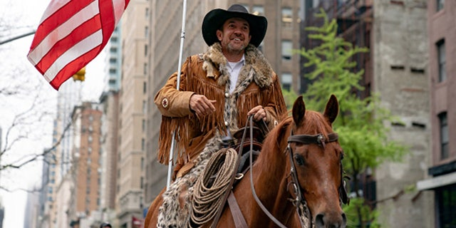 NEW YORK, NY - MAY 01: Otero County Commission Chairman and Cowboys for Trump co-founder Couy Griffin rides his horse on 5th avenue on May 1, 2020 in New York City. (Photo by Jeenah Moon/Getty Images)