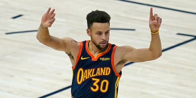 Golden State Warriors guard Stephen Curry celebrates after scoring a 3-pointer against the Utah Jazz during the first half of an NBA basketball game Saturday, Jan. 23, 2021, in Salt Lake City. (Associated Press)