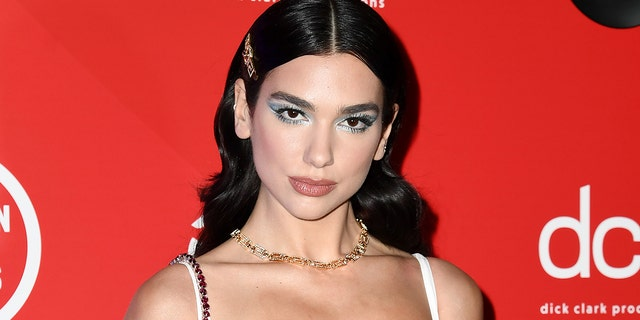 Dua Lipa responded to backlash she received last year after a strip club outing with Lizzo and Lil Nas X following the Grammy Awards. (Photo by Gareth Cattermole/Getty Images for dcp)