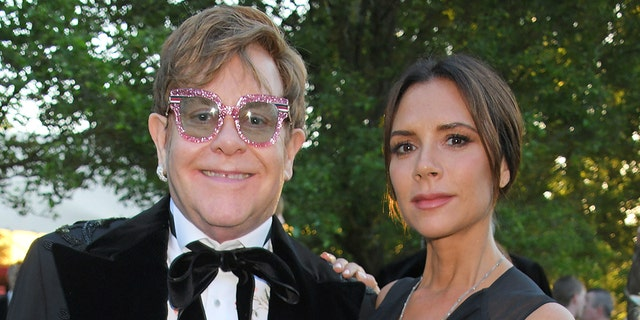 Victoria Beckham (right) said that watching Elton John (left) perform 'Tiny Dancer' helped her realize she wanted to leave the music industry. (Photo by David M. Benett/Dave Benett/Getty Images for BVLGARI and EJAF)