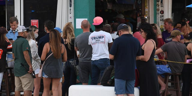People pack Fort Lauderdale bars Sunday, when the state of Florida reported another 10,603 COVID-19 cases, the eighth consecutive day with an average of 11,000-plus new cases per day.