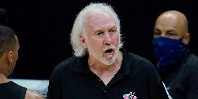 San Antonio Spurs coach Gregg Popovich, center, yells from the sideline during the fourth quarter of the team's NBA basketball game against the Los Angeles Clippers on Tuesday, Jan. 5, 2021, in Los Angeles. (AP Photo/Ashley Landis)