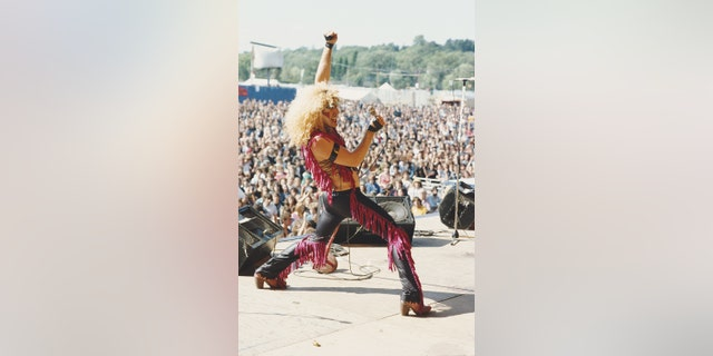 American singer Dee Snider performs live on stage with glam metal group Twisted Sister at the Reading Festival in Reading, England, in 1982.