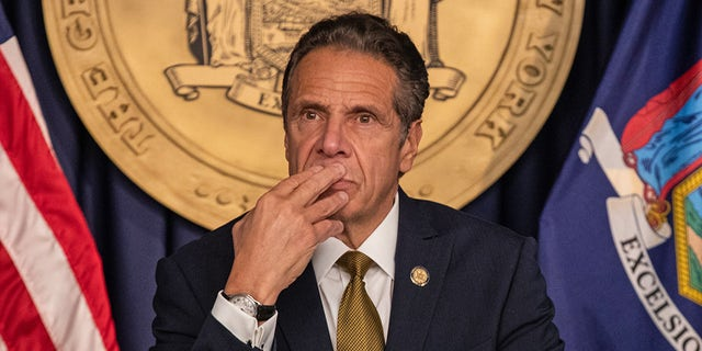 Andrew Cuomo, governor of New York, pauses while speaking during a news conference in New York, Oct. 5, 2020. Photographer: Jeenah Moon/Bloomberg via Getty Images