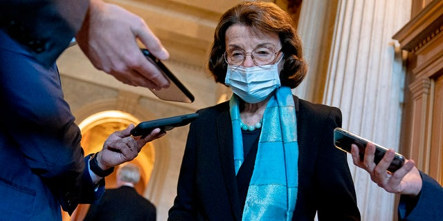 U.S. Sen. Dianne Feinstein (D-CA) wears a protective mask while speaking to reporters at the U.S. Capitol on December 11, 2020 in Washington, DC. (Photo by Stefani Reynolds/Getty Images)