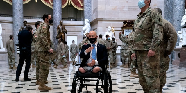 Rep. Brian Mast, R-Fla., gives members of the National Guard a tour of the U.S. Capitol on Jan. 13, 2021, in Washington, D.C. (Stefani Reynolds/Getty Images)