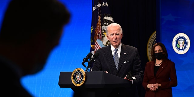 "President Joe Biden with Vice President Kamala Harris answers questions from the media after signing a ""Made in America"" Executive Order in the South Court Auditorium at the White House on January 25, 2021, in Washington, D.C. (Photo by JIM WATSON/AFP via Getty Images)"