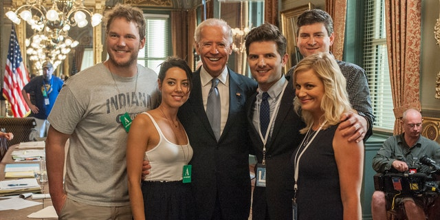 Pictured: (l-r) Chris Pratt as Andy, Aubrey Plaza as April Ludgate, then-Vice President Joe Biden, Adam Scott as Ben Wyatt, Amy Poehler as Leslie Knope, EP Mike Schur
