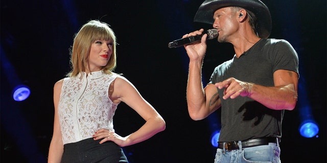 Singers Taylor Swift and Tim McGraw perform during the 2013 CMA Music Festival on June 6, 2013, in Nashville, Tennessee.