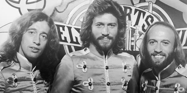 1977: L-R: Brothers Robin, Barry and Maurice Gibb of the Bee Gees. Barry Gibb is the sole surviving member of the group.