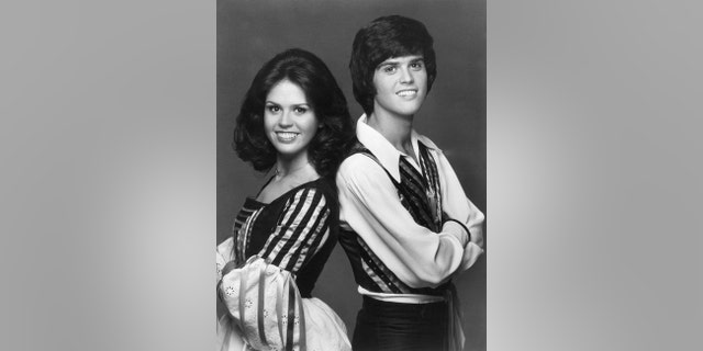 Portrait of sibling singers Donny and Marie Osmond, 1975.