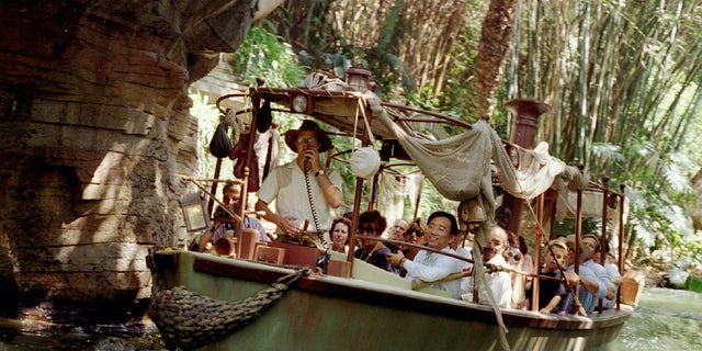 A photo of a tour group on the Jungle Cruise in Disneyland.