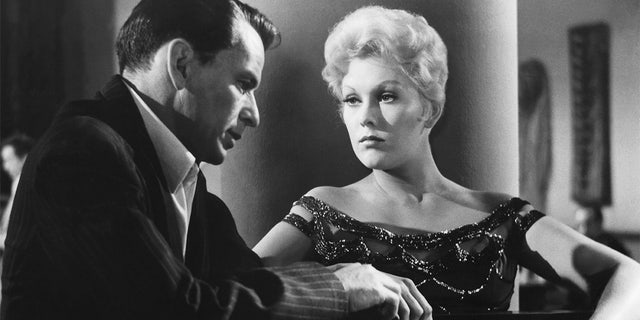 American actors Frank Sinatra and Kim Novak on the set of 'The Man with the Golden Arm,' directed by Austro–Hungarian-American Otto Preminger.