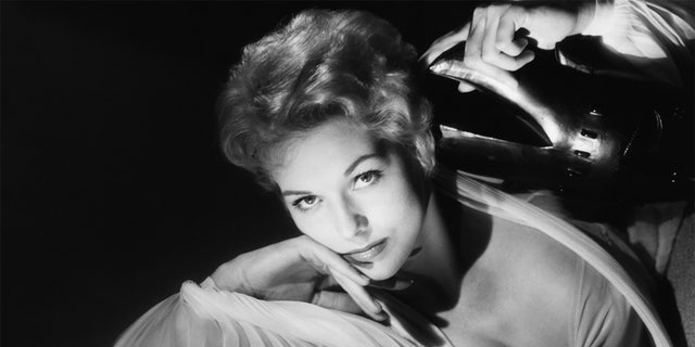 In her new book, Kim Novak admitted she felt 'dazzled and disturbed' to see herself as a sex symbol.