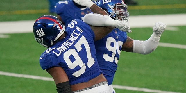 New York Giants' Leonard Williams, right, celebrates a sack with Dexter Lawrence (97) during the second half of an NFL football game against the Dallas Cowboys, Sunday, Jan. 3, 2021, in East Rutherford, N.J. (AP Photo/Corey Sipkin)