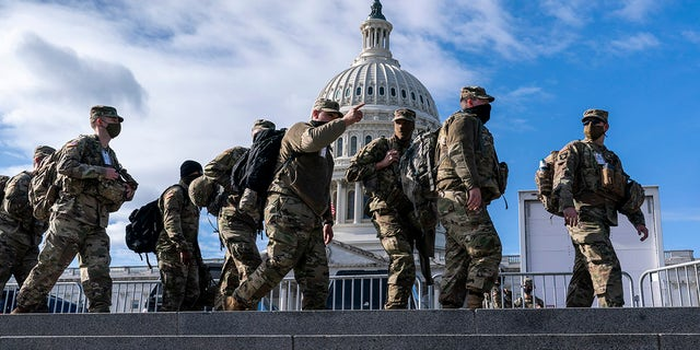 National Guardsmen reinforce security around the U.S. Capitol ahead of the inauguration of President-elect Joe Biden and Vice President-elect Kamala Harris, Sunday, Jan. 17, 2021, in Washington. (AP Photo/J. Scott Applewhite)