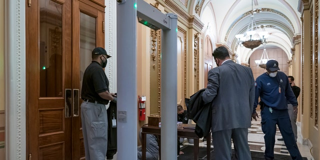Metal detectors for lawmakers are installed in the corridor around the House of Representatives chamber after a mob loyal to President Donald Trump stormed the Capitol last week, in Washington, Tuesday, Jan. 12, 2021.