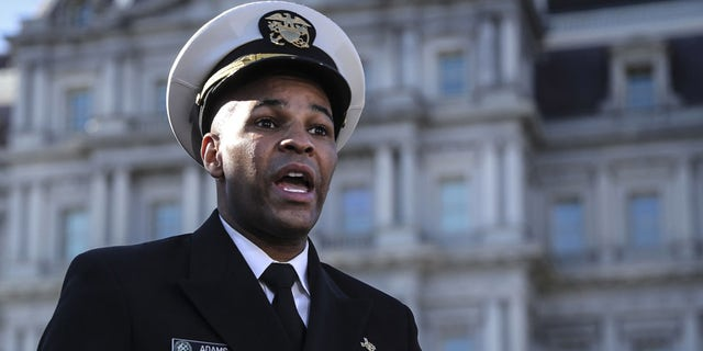 Vice Admiral Jerome Adams, U.S. surgeon general, speaks during a television interview outside the White House in Washington, D.C., Dec. 8, 2020. (Oliver Contreras/Sipa/Bloomberg via Getty Images)