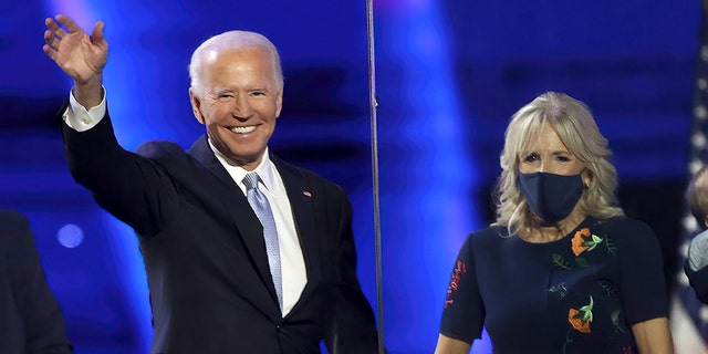 Then President-elect Joe Biden and Jill Biden wave to the crowd after Biden's address to the nation from the Chase Center November 07, 2020 in Wilmington, Delaware. (Photo by Tasos Katopodis/Getty Images)