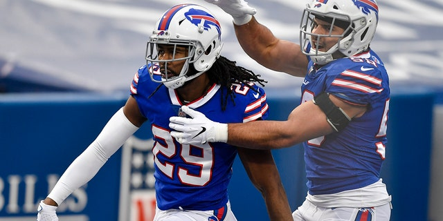 Buffalo Bills cornerback Josh Norman (29) celebrates his touchdown with outside linebacker Matt Milano (58) in the second half of an NFL football game against the Miami Dolphins, Sunday, Jan. 3, 2021, in Orchard Park, N.Y. (AP Photo/Adrian Kraus)