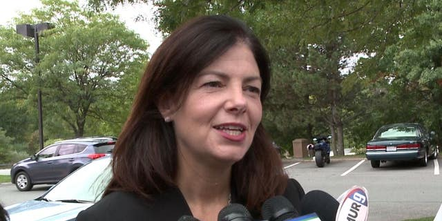 Then-Sen. Kelly Ayotte of New Hampshire speaks to reporters during her 2016 re-election campaign.