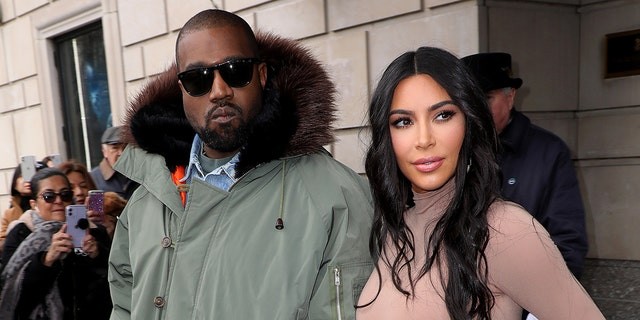 """Kim Kardashian has yet to officially file divorce papers because she wants to """"make the right decision"""" for their four children, a source claims."""