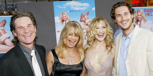 Left to right: Kurt Russell, Goldie Hawn, Kate Hudson and Oliver Hudson are famously close with one another. (Photo by Vince Bucci/Getty Images)