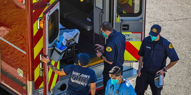 After administering him with oxygen, County of Los Angeles paramedics load a potential COVID-19 patient in the ambulance before transporting him to a hospital in Hawthorne, California on December 29, 2020. (Photo by APU GOMES/AFP via Getty Images)