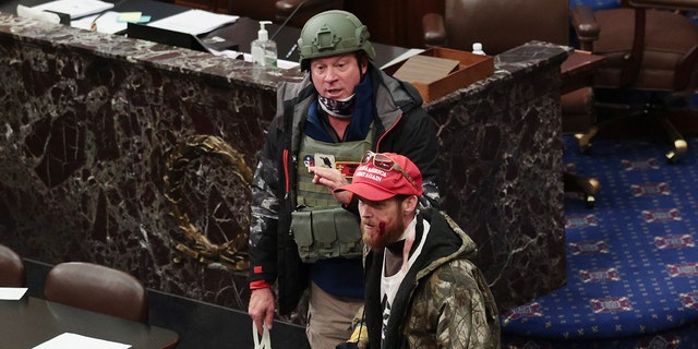 Larry Brock Jr. has been identified wearing a helmet on the Senate floor as pro-Trump rioters stormed the U.S. Capitol building Wednesday after mass demonstrations. (Photo by Win McNamee/Getty Images)