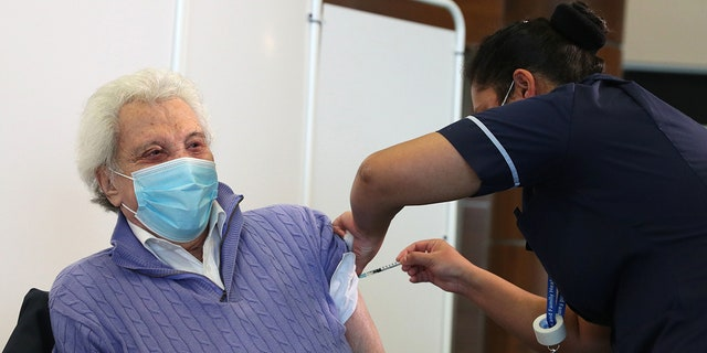 Entertainer Lionel Blair, age 92, received his vaccine in Britain.