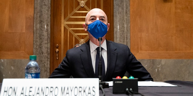 Homeland Security Secretary nominee Alejandro Mayorkas takes his seat to testify during his confirmation hearing in the Senate Homeland Security and Governmental Affairs Committee on Tuesday, Jan. 19, 2021, on Capitol Hill in Washington. (Bill Clark/Pool via AP)