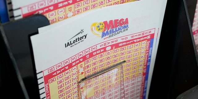 Blank forms for the Mega Millions lottery sit in a bin at a local grocery store on Jan. 12, 2021, in Des Moines, Iowa.  (AP Photo/Charlie Neibergall)