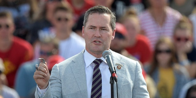 FILE - In this Friday, Oct. 16, 2020 file photo, Rep. Michael Waltz, R-Fla., speaks before President Donald Trump during a campaign rally at the Ocala International Airport in Ocala, Fla. (AP Photo/Phelan M. Ebenhack, File)