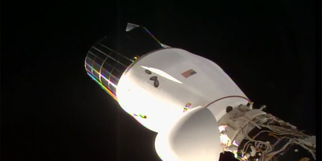 This image shows the SpaceX Cargo Dragon vehicle docked to the Harmony module's space-facing international docking adapter.