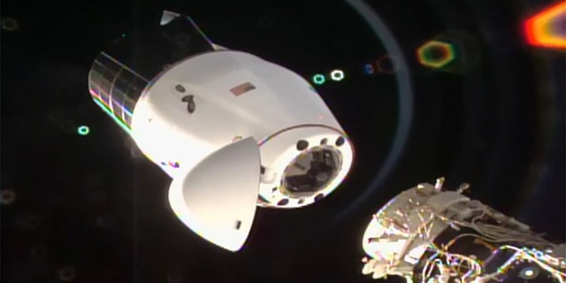 SpaceX's Cargo Dragon spacecraft begins its undocking from the International Space Station.