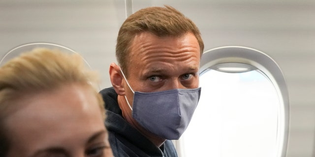 Alexei Navalny and his wife, Yulia sit in the plane prior to their flight to Moscow in the Airport Berlin Brandenburg (BER) in Schoenefeld, near Berlin, Germany, Sunday, Jan. 17, 2021.
