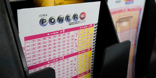 The Powerball jackpot has grown to $  640 million ahead of its next drawing Saturday, while the Mega Millions jackpot has soared to $  750 million ahead of Friday night's drawing. (AP Photo/Charlie Neibergall)