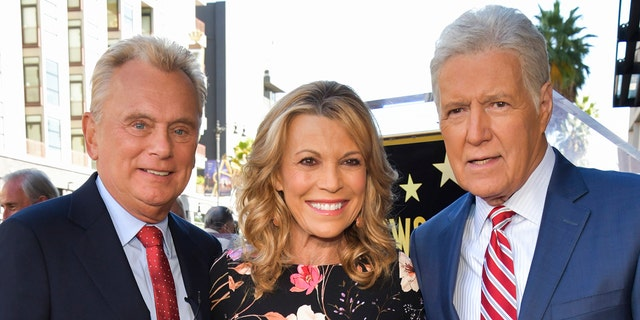'Wheel of Fortune' hosts Pat Sajak (left) and Vanna White (center) opened up about their 'admiration' for 'Jeopardy!' host Alex Trebek (right) after his death. (Photo by Rodin Eckenroth/WireImage)