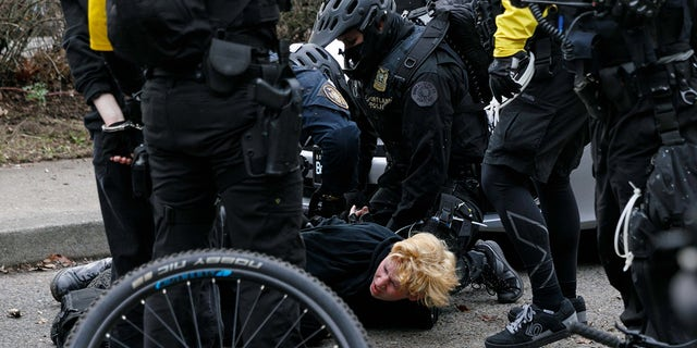 Black Block, anarchists, and antifascist activists opposed to Joe Biden marched and demonstrated in Portland, Oregon on Inauguration Day, January 20 2021, resulting in a few broken windows and eight arrests. (Photo by John Rudoff/Sipa USA)