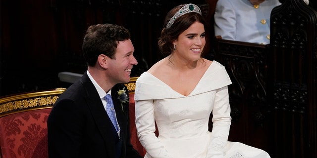 Britain's Princess Eugenie and Jack Brooksbank during their wedding ceremony in St George's Chapel, Windsor Castle, near London, England, Friday, Oct. 12, 2018.
