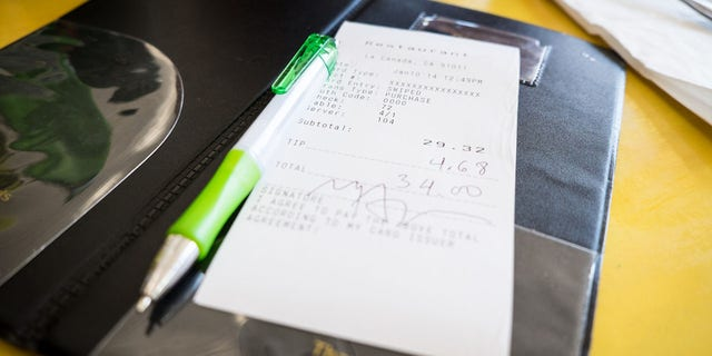 A customer at a Colorado cafe left a $1,400 tip on a $20 meal to be split among the cafe's seven workers. (iStock)