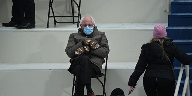 Vermont Sen. Bernie Sanders sits in the bleachers on Capitol Hill during President Joe Biden's inauguration. (Photo by BRENDAN SMIALOWSKI/AFP via Getty Images)