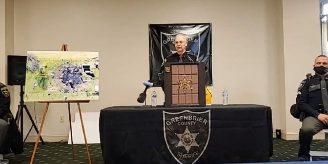 Greenbrier County Sheriff Bruce Sloan holds a press conference Thursday to give an update on a deadly shooting and fire that killed five children and one adult in December. A woman killed the children and set her home on fire before killing herself.