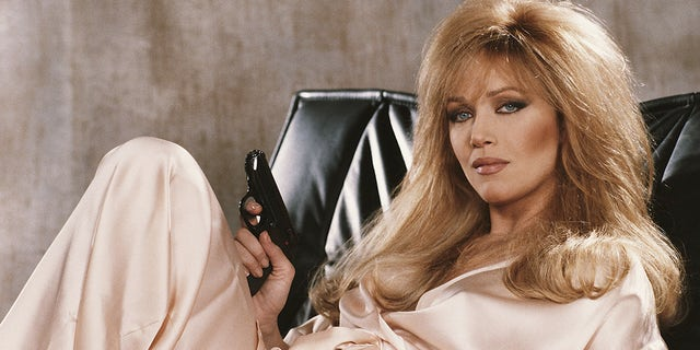 American actress Tanya Roberts stars as Stacey Sutton in the James Bond film 'A View To A Kill', 1985. She is holding Bond's trademark Walther PPK.