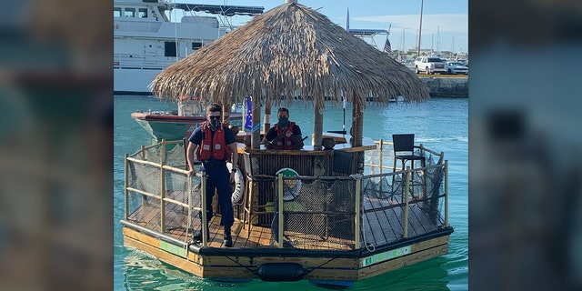 "Photos show USCG members at the ""helm"" of the floating bar and on deck as they brough it back to harbor."