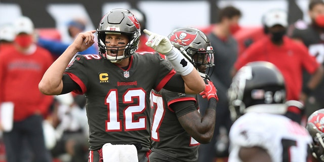 Tampa Bay Buccaneers quarterback Tom Brady (12) calls a play against the Atlanta Falcons during the second half of an NFL football game Sunday, Jan. 3, 2021, in Tampa, Fla. (AP Photo/Jason Behnken)