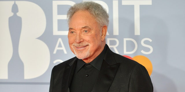 Singer Tom Jones said that getting vaccinated is the 'one good thing about being 80.' (Photo by Jim Dyson/Redferns)