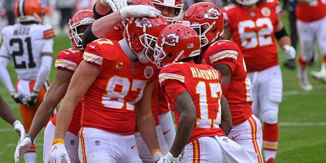 Kansas City Chiefs tight end Travis Kelce (87) celebrates with teammates after scoring on a 20-yard touchdown reception during the first half of an NFL divisional round football game against the Cleveland Browns, Sunday, Jan. 17, 2021, in Kansas City. (AP Photo/Reed Hoffmann)
