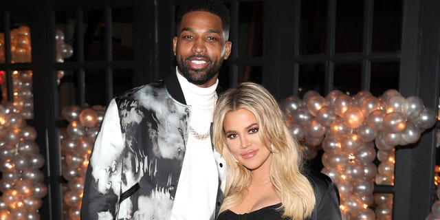 Tristan Thompson and Khloe Kardashian pose for a photo as Remy Martin celebrates Tristan Thompson's Birthday at Beauty & Essex on March 10, 2018 in Los Angeles, California.