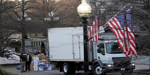A van arrives to pick up boxes that were moved out of the Eisenhower Executive Office building. (AP)